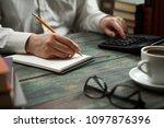 business man calculate about...   Shutterstock . vector #1097876396
