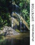 beautiful pha nam yod waterfall | Shutterstock . vector #1097877338