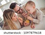 family drinking fresh orange... | Shutterstock . vector #1097879618