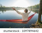 young woman by the lake hanging ... | Shutterstock . vector #1097894642