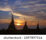 dark huts sunset silhouettes at ... | Shutterstock . vector #1097897516