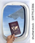 the hand holds a passport in... | Shutterstock . vector #1097913386