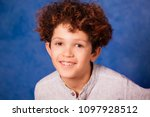 portrait of smiling young boy... | Shutterstock . vector #1097928512