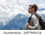 young traveller looking into... | Shutterstock . vector #1097940116