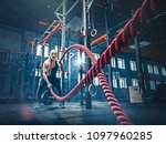 woman with battle rope battle... | Shutterstock . vector #1097960285