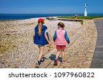 Kids Walking At Embankment Of...
