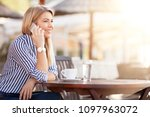beautiful busy woman phoning... | Shutterstock . vector #1097963072