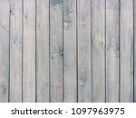 A Gray Wooden Fence With...