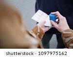 hands of female border guard ... | Shutterstock . vector #1097975162