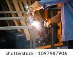 welding. a welder arc welds... | Shutterstock . vector #1097987906