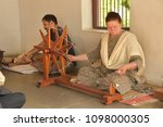 Small photo of AHMEDABAD, GUJARAT, INDIA, MAY 14, 2018: Demonstration of Charkha (spinning wheel) at the Sabarmati Ashram. Charkha was both a tool and a symbol of the Indian independence movement. Indians, foreigner