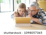 daddy and daughter having fun... | Shutterstock . vector #1098057365