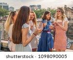 girls party on balcony.... | Shutterstock . vector #1098090005