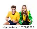 Stock photo  a couple of brazilians cheering for brazil 1098092222