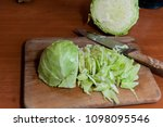 chop cabbage for borscht or soup | Shutterstock . vector #1098095546