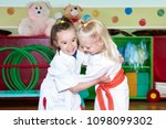 little sportswomen train... | Shutterstock . vector #1098099302