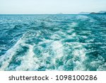 wave trace with white foam on... | Shutterstock . vector #1098100286
