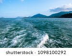 wave trace with white foam on... | Shutterstock . vector #1098100292
