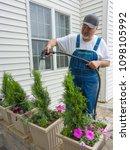 man working in his yard... | Shutterstock . vector #1098105992
