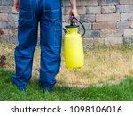 man holding a plastic yellow... | Shutterstock . vector #1098106016