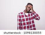 upset unhappy afro american man ...   Shutterstock . vector #1098130055