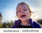 little disheveled girl crying...   Shutterstock . vector #1098149318