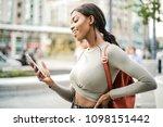girl checking her phone  | Shutterstock . vector #1098151442