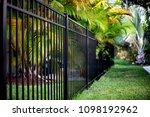 black aluminum fence  | Shutterstock . vector #1098192962
