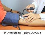 doctor checking blood pressure...   Shutterstock . vector #1098209315