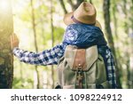 a woman with a backpack and a... | Shutterstock . vector #1098224912