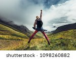 young man traveler jumps on a... | Shutterstock . vector #1098260882