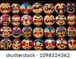 rows of hanging face painted on ...   Shutterstock . vector #1098324362