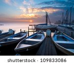 Rental boats in an marina during sunrise - stock photo