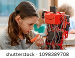 young girl building a robot.... | Shutterstock . vector #1098389708