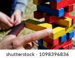 kid s finger holding yellow...   Shutterstock . vector #1098396836