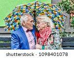 elderly couple on a walk in the ... | Shutterstock . vector #1098401078