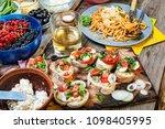 traditional italian snacks at... | Shutterstock . vector #1098405995