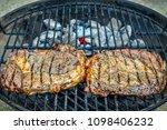 two seasoned steaks sitting...   Shutterstock . vector #1098406232