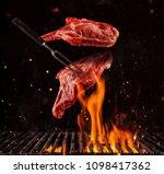 flying pieces of pork chops... | Shutterstock . vector #1098417362
