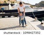 beautiful mother is walking on... | Shutterstock . vector #1098427352