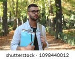 handsome male student outdoors...   Shutterstock . vector #1098440012