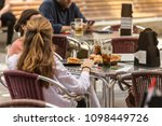 girls sitting at a table eating ...   Shutterstock . vector #1098449726