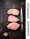 raw meat of turkey steak on... | Shutterstock . vector #1098459152