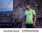 young handsome tattooed man...   Shutterstock . vector #1098464006
