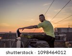 young handsome tattooed man...   Shutterstock . vector #1098464012