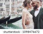 happy wedding couple near the... | Shutterstock . vector #1098476672