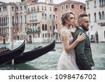 tender wedding couple near the... | Shutterstock . vector #1098476702