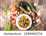 cooking homemade ratatouille | Shutterstock . vector #1098482576