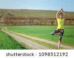 young girl doing yoga outdoor   Shutterstock . vector #1098512192