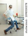 male dentist exercising in his... | Shutterstock . vector #1098530378